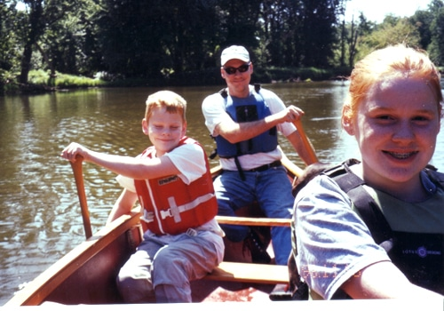 A family doing boating.