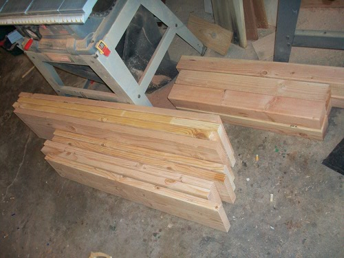 piles of cut measured lumber homemade dining table