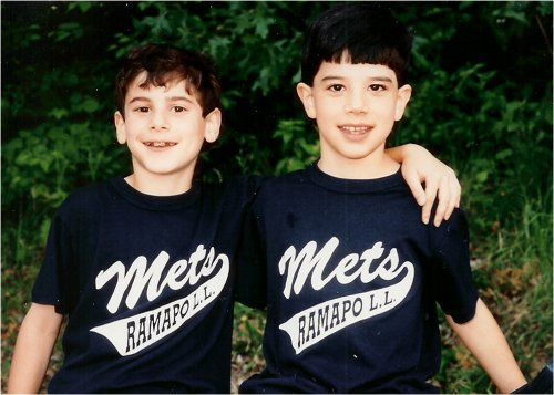 young boys brothers mets shirts arm around each other