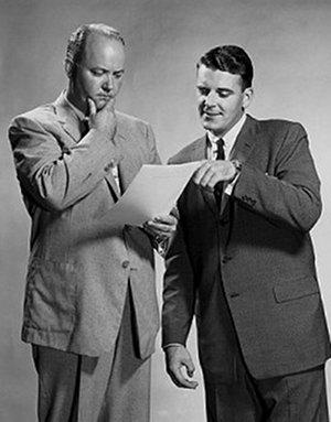 vintage businessmen pondering looking at papers