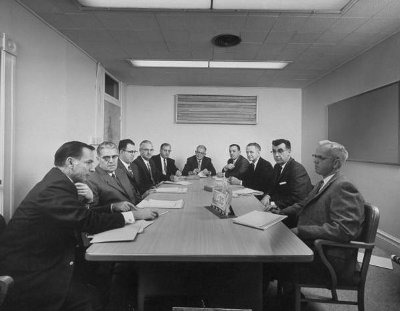 vintage businessmen at conference table meeting suits