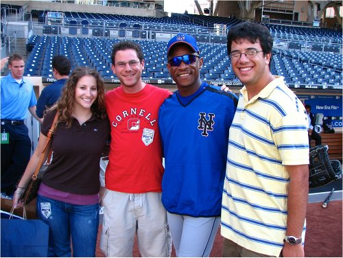 Ricky Henderson mets posing with fans on baseball field