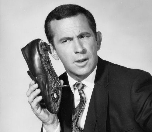 don adam holding shoe telephone phone to ear