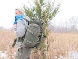 Creek Stewart carrying training bag in forest.
