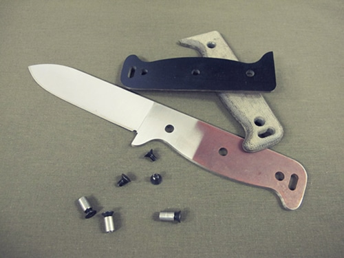 Opened survival knife handle.