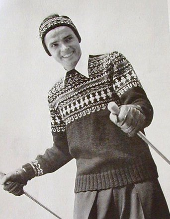 Vintage man wearing sweater and cap with ski poles.