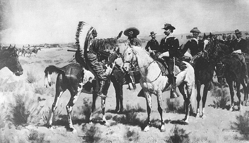 Vintage native American chief speaking to white men on horses.