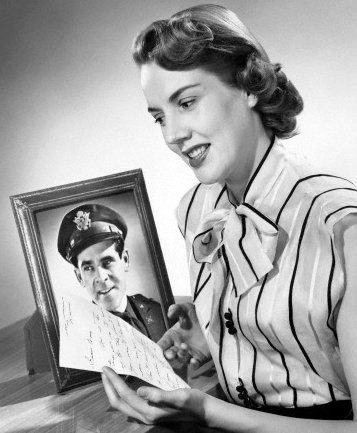 vintage woman reading handwritten letter from soldier