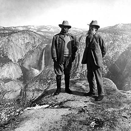 teddy roosevelt in yellowstone canyon posing on rock