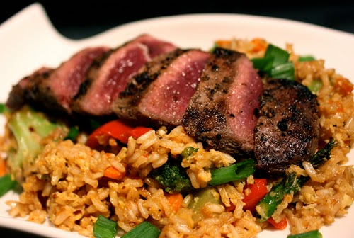 Pan seared wild duck breasts over brown rice.
