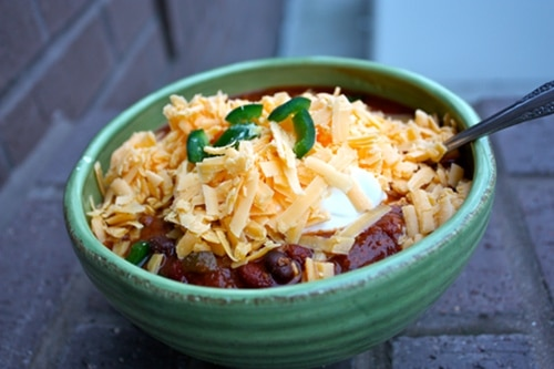 Venison chili with sour cream cheese served in a bowl.