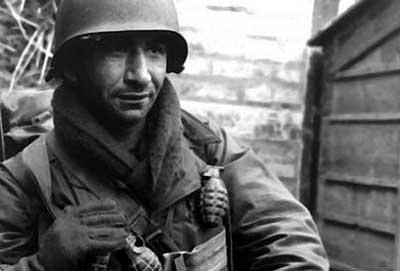 Vintage soldier in uniform wearing scarf.
