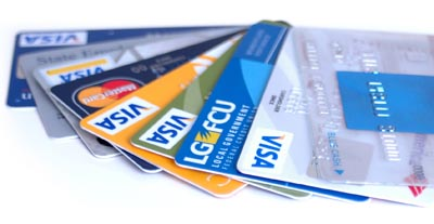 Fanned out stack of visa credit cards.