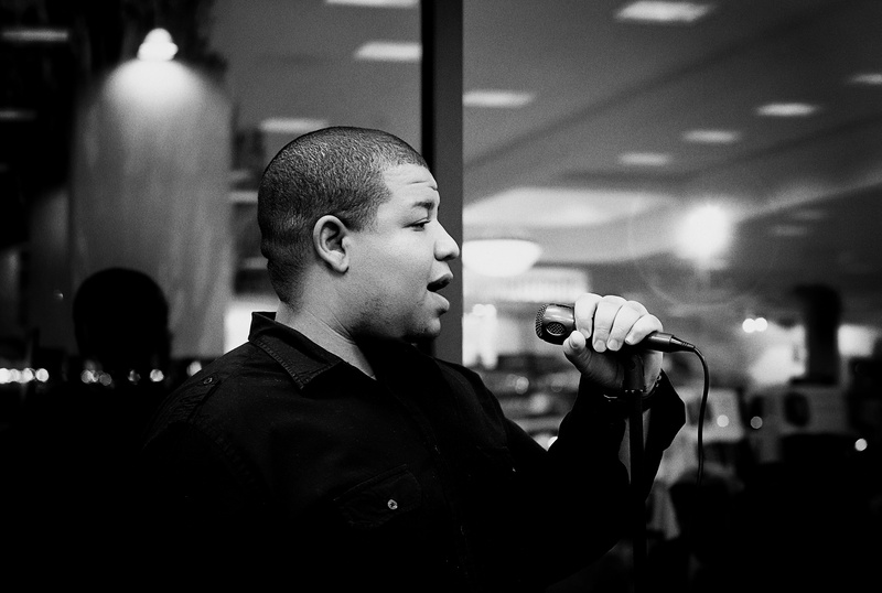 jordan chaney african american poet on stage with microphone