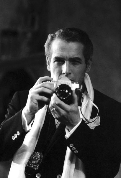 vintage man with camera wearing scarf and blazer