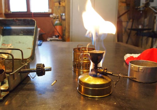 portable camp stove lit flame flare up
