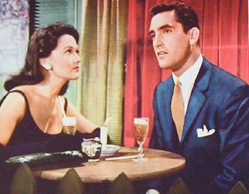 vintage couple on date man looking away eye contact