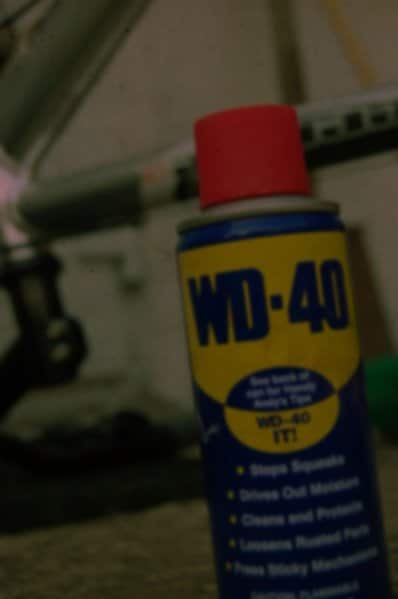 can of wd-40 in garage with red cap
