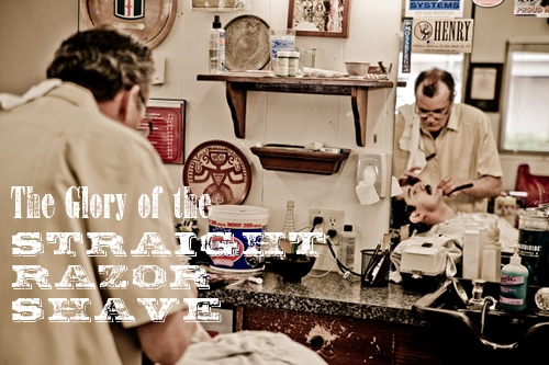 man in barbershop getting straight razor shave