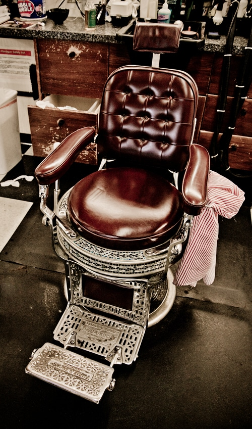 vintage leather barbershop chair with metal casing
