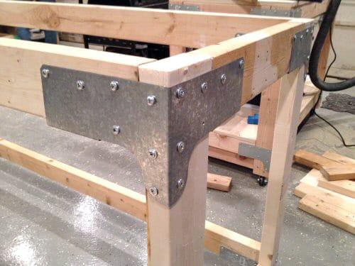 Screws fitted in ties of plywood.
