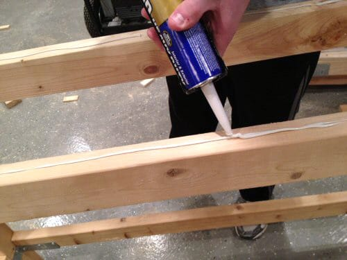 Applying glu on the top of plywood.