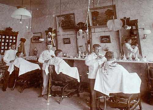 vintage barbershop late 1800s men getting hair cut