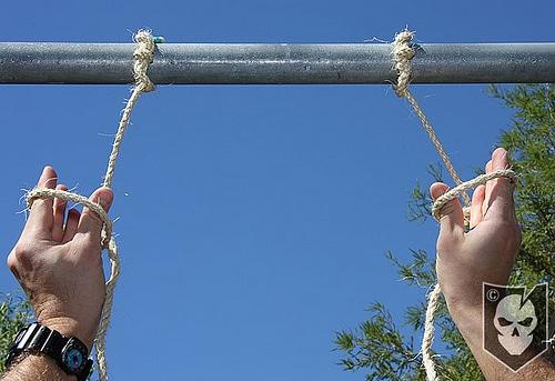 Man making holes of ropes.