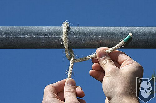 Man tighten the rope with pipe.