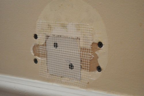 Using mesh tape for covering drywall.