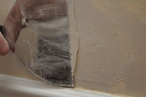 Applying compound on drywall.