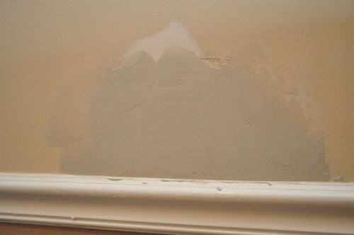 Removing the edges of drywall.
