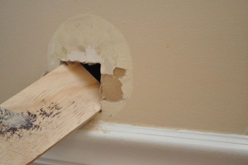 Inserting the bracket board on dry wall.