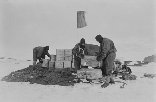 Men loading boxes on sledge.