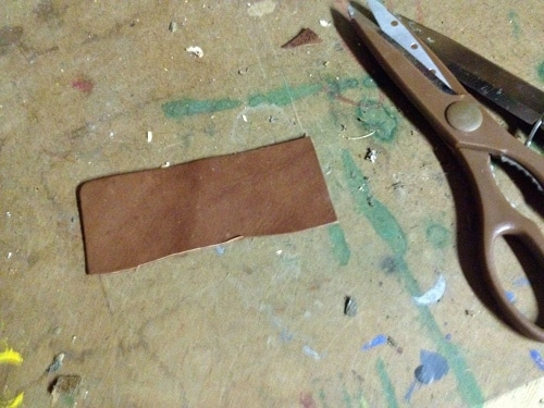Vintage cutting a rectangle that's about four inches wide and two inches high.