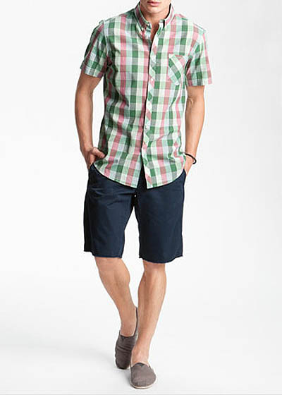 Man wearing shirt that go with shorts portrait.