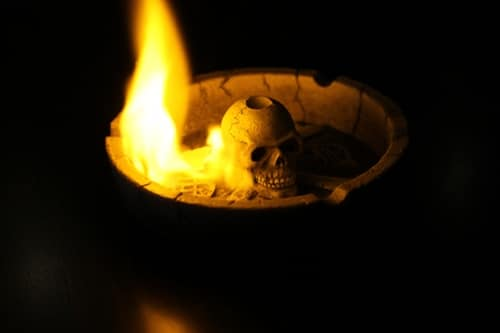 Skull in a burning fire bowl.