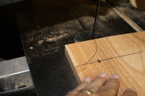 Vintage using band saw to cutting the arcs out.