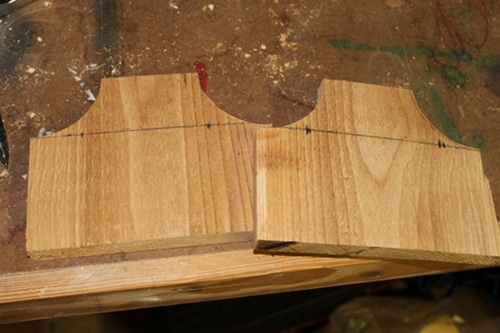 Vintage two end pieces with the arcs cut out from the corners.
