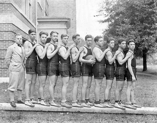 Vintage basketball team standing in line black and white illustration.