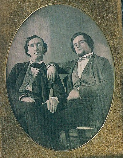 Vintage two men are siting wearing suites black and white photo illustration.