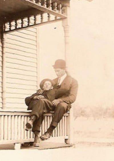 Vintage men with little boy sitting black and white photo illustration.