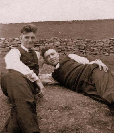 Vintage young boys are laying front of stones wall, black and white photo illustration.