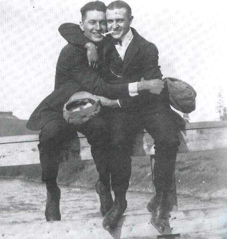 Vintage two men sitting and hugging each other black and white illustration.