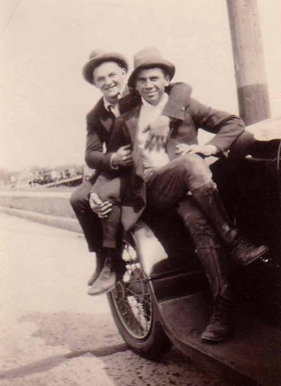Vintage two young men sitting on vehicle black and white illustration.