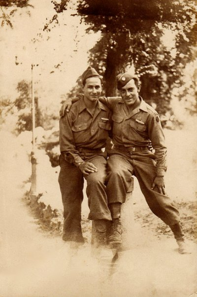 Vintage two army soldiers sitting black and white illustration.