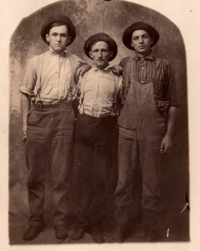 Vintage three young men standing and wearing hats black and white illustration.