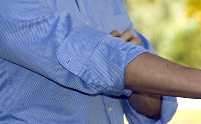 Roll shirt sleeves close up photo right arms.