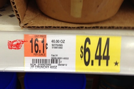 Grocery store price label unit price pointed out.