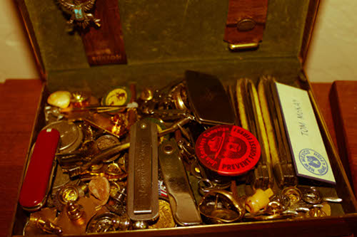 man's treasure box knives coins pins lapels